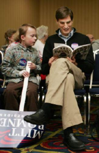 Josh Romney, son of presidential candidate Mitt Romney, talks with Jack Andereck, 8, while looking at a magazine at the Laramie County GOP County Convention in Cheyenne, Wyo. Saturday, Jan. 5, 2008. Mitt Romney captured his first win of the Republican presidential race on Saturday, prevailing in Wyoming caucuses for a much-needed boost to his candidacy three days before the New Hampshire primary. (AP Photo/The Wyoming Tribune Eagle, Brandon Quester)