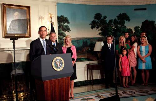 WASHINGTON - MAY 16:  (AFP OUT) Gov. Jon Huntsman (R-UT) (2L), his wife Mary Kaye (3L) and his family listen to President Barack Obama (L) speak in the Diplomatic Reception Room of the White House May 16, 2009 in Washington DC.  President Barack Obama nominated Utah Governor Jon M. Huntsman Jr., as the American ambassador to China.  (Photo by Brendan Smialowski-Pool/Getty Images) *** Local Caption *** Barack Obama;Mary Kaye;Jon Huntsman