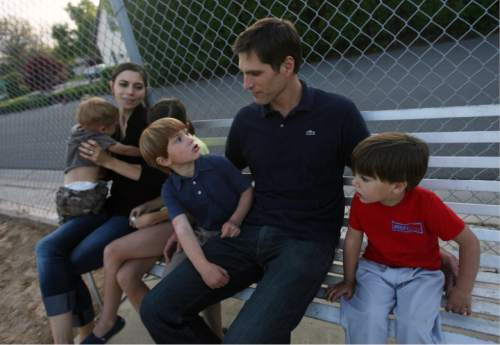 Kim Raff | The Salt Lake Tribune  Josh Romney gets off the campaign trail during his father's bid for president to spend time with his wife Jen and their family together at their son's baseball practice at an LDS stake house in Holladay, Utah on May 3, 2012.