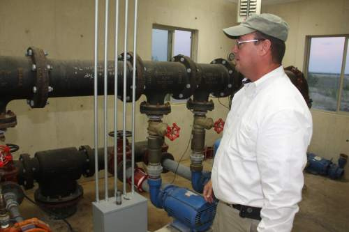 Kathy Mankin  |  The Eldorado Success   In this 2014 photo, Schleicher County Sheriff David Doran inspects the the Public Water System building at the YFZ Ranch. Doran has been ordered by the court to oversee and maintain the ranch until such time as it can be sold by the Texas General Land Office.