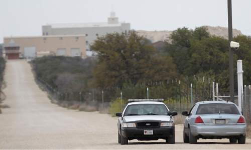 Jennifer Rios  |  Standard-Times  Texas Department of Public Safety cars idle along a road on the Yearning for Zion Ranch Thursday afternoon. A writ of possession was filed in the Schleicher County District Court in the Attorney General's civil case against the ranch. It was served Wednesday.