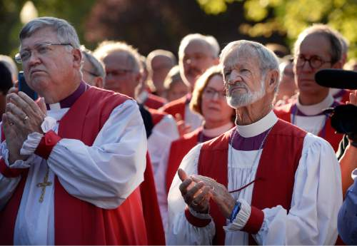 Scott Sommerdorf   |  The Salt Lake Tribune Episcopal bishops applaud speakers at a stop in Pioneer Park as they marched to protest gun violence. The march  by more than 60 Episcopal bishops and and about 2,000 in all, took place Sunday, June 28, 2015. The march started at The Salt Palace, went to Pioneer Park and returned to the Salt Palace - site of the General Convention of the Episcopal Church.