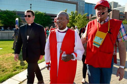 Scott Sommerdorf   |  The Salt Lake Tribune Bishop Michael Curry of North Carolina, center, who was elected at the 27th Presiding Bishop of the Episcopal Church is escorted back into the Salt Palace after marching to protest gun in Salt Lake City, Sunday, June 28, 2015.