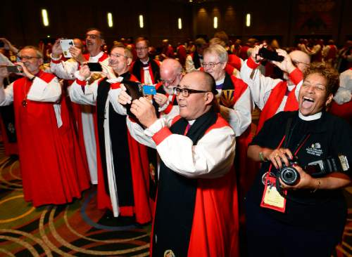 Scott Sommerdorf   |  The Salt Lake Tribune Episcopal bishops scramble to take their own photos of a rare grouping of all 18 female Episcopal bishops at the General Convention of the Episcopal Church held at the Salt Palace, Sunday, June 28, 2015.