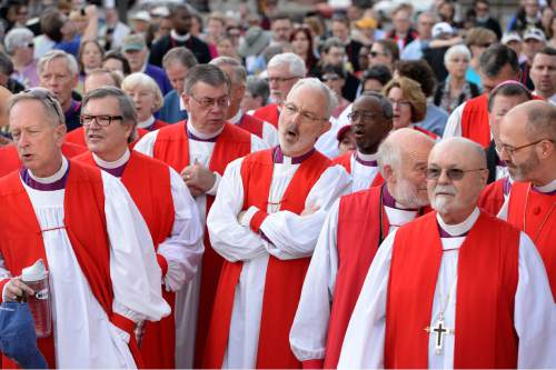 Scott Sommerdorf   |  The Salt Lake Tribune Episcopal bishops sing prior to a march against gun violence by more than 60 Episcopal bishops and and about 2,000 in all, Sunday, June 28, 2015. The march started at The Salt Palace, went to Pioneer Park and returned to the Salt Palace - site of the General Convention of the Episcopal Church.