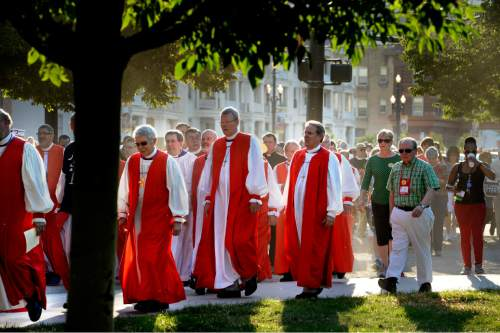 Scott Sommerdorf   |  The Salt Lake Tribune More than 60 Episcopal bishops and and about 2,000 in all march toward Pioneer Park to protest against gun violence, Sunday, June 28, 2015. They later returned to the Salt Palace, site of the General Convention of the Episcopal Church.