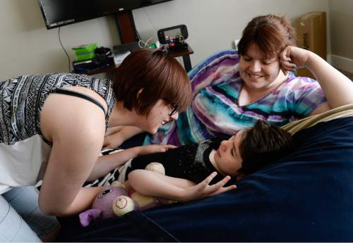 Francisco Kjolseth | The Salt Lake Tribune   Emily Knowlton, 19, jokes around with her sister Isabelle, 10, who is among dozens of Utah epileptic children and adults now receiving therapeutic hemp oil with permission from the state. Since she began taking under-the-tongue drops, Isabelle has gone seizure-free, said her mother, Syndi Knowlton, at right.