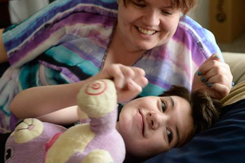 Francisco Kjolseth | The Salt Lake Tribune   Isabelle Knowlton, 10, is among dozens of Utah epileptic children and adults now receiving therapeutic hemp oil with permission from the state. Since she began taking under-the-tongue drops, Isabelle has gone seizure-free, said her mother, Syndi Knowlton.