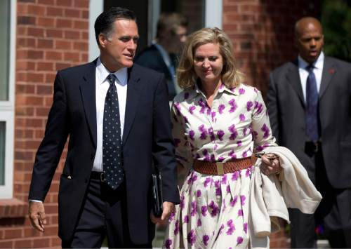 FILE - Republican presidential candidate, former Massachusetts Gov. Mitt Romney and his wife Ann, leave a Church of Jesus Christ of Latter-day Saints meetinghouse after services on Sunday, Sept. 2, 2012 in Wofeboro, N.H.  (AP Photo/Evan Vucci)