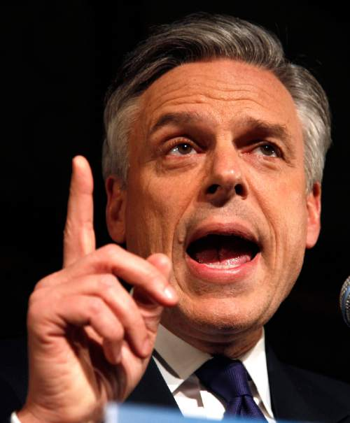 Republican presidential candidate, former Utah Gov. Jon Huntsman gestures during a New Hampshire primary night party in Manchester, N.H., Tuesday Jan. 10, 2012. (AP Photo/Charles Krupa)
