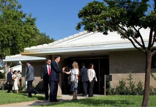 FILE - Republican presidential candidate, former Massachusetts Gov. Mitt Romney talks with congregants as he leaves a Church of Jesus Christ of Latter-day Saints meetinghouse after services on Sunday, Oct. 21, 2012 in Boca Raton, Fla.  (AP Photo/ Evan Vucci)