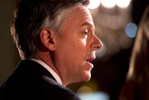 Republican presidential candidate, former Utah Gov. Jon Huntsman speaks at a primary election night rally Tuesday, Jan. 10, 2012, in Manchester, N.H.  (AP Photo/Evan Vucci)