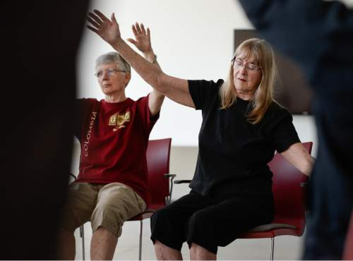 Francisco Kjolseth | The Salt Lake Tribune   Sylvia Mathis, left, and LaRue Biggs imagine their arms to be limbs of a tree swaying in the wind as they attend a dance class that helps people with Parkinson's Disease maintain motor skills. In a collaboration between the Department of Physical Therapy and the Department of Modern Dance at the University of Utah people living with the disease lose the role of patient and engage through movement and imagination in a fun class.