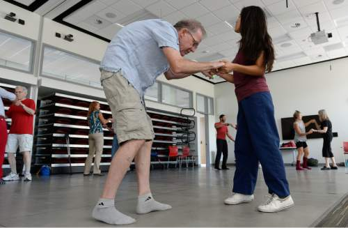 Francisco Kjolseth | The Salt Lake Tribune   Wes Starkenburg dances with his caregiver Raisa Lozano during a class at the University of Utah that uses dance, creative movement, and physical therapy to help people with Parkinson's Disease. Research has shown that dancing helps Parkinson's patients with motor skills.