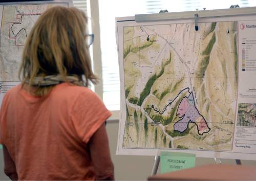 Al Hartmann |  The Salt Lake Tribune A person looks at a map with proposed tar sands mine footprint on the Uintah- Grand County line at a crucial hearing at the Utah Division of Oil, Gas and Mining Tuesday, June 30 at the Utah Department of Natural Resources building in Salt Lake City.