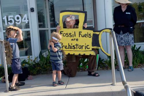 Al Hartmann |  The Salt Lake Tribune Paul Wickelson and his sons Otis, 6, and Lev, 3, performed a skit on the steps of the Utah Department of Natural Resources before a crucial hearing Tuesday, June 30 at the Utah Division of Oil, Gas and Mining in Salt Lake City.