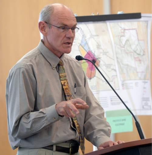 Al Hartmann |  The Salt Lake Tribune Paul Baker with Utah Minerals Regulatory Program speaks at a crucial hearing Tuesday, June 30 at the Utah Division of Oil, Gas and Mining in Salt Lake City.
