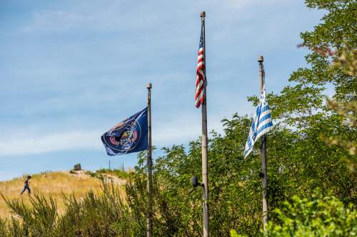 Chris Detrick  |  The Salt Lake Tribune The Flag of Utah, American Flag and Deseret Flag at Ensign Peak Nature Park Wednesday July 1, 2015.
