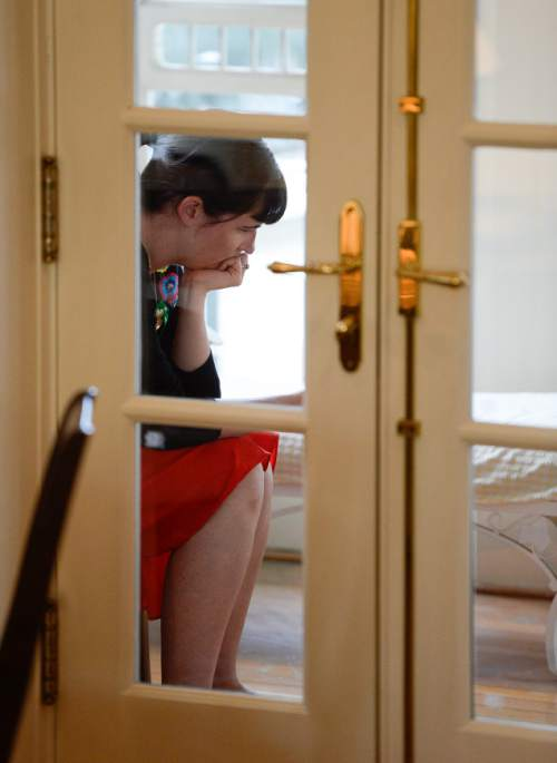 Francisco Kjolseth  |  The Salt Lake Tribune Kate Kelly, founder of Ordain Women, checks messages of support and requests for interviews during a quiet moment at a bed and breakfast near the Church of Jesus Christ of Latter Day Saints after getting an official message through email that she has been excommunicated on Monday, June 23, 2014.