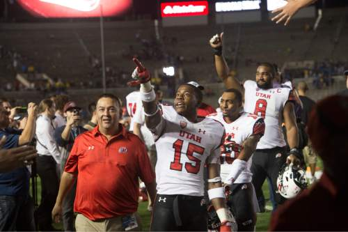 Rick Egan  |  The Salt Lake Tribune  Utah Utes wide receiver Dominique Hatfield (15) and The Utes celebrate their 30-28 upset over UCLA as they head to the locker room, in Pac 12 action, at the Rose Bowl, Saturday, October 4, 2014