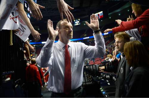 "Scott Sommerdorf   |  The Salt Lake Tribune Utah Utes head coach Larry Krystkowiak leaves the court after Utah defeated Georgetown 75-64 to advance to the ""Sweet Sixteen"", Saturday, March 21, 2015."