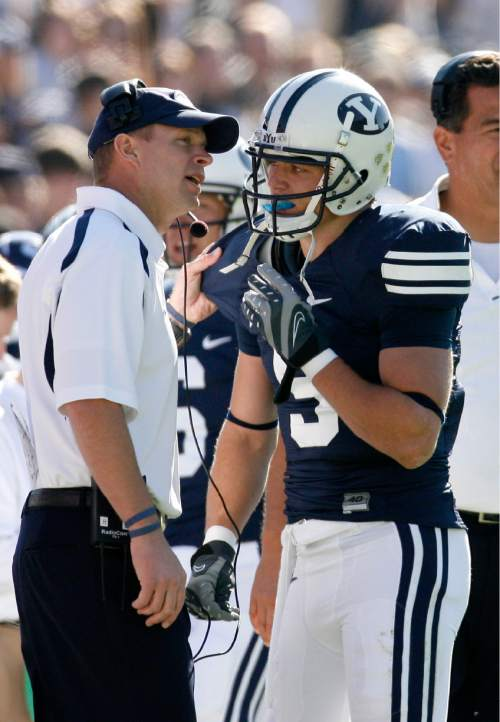 Chris Detrick  |  The Salt Lake Tribune  BYU head coach Bronco Mendenhall talks with Austin Collie after he scored a touchdown during the first half of the game against Colorado State at LaVell Edwards Stadium November 3, 2007. BYU won 35-16.