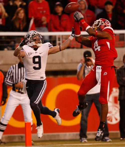 Trent Nelson  |  The Salt Lake Tribune  BYU wide receiver Austin Collie (9) is defended by Utah's Sean Smith on an incomplete pass during the Utah BYU game Saturday November 22, 2008.