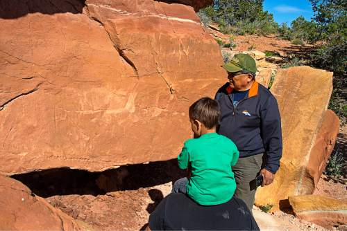 Courtesy  |  Tim Peterson  Ben Nuvamsa, Former Chairman of the Hopi Tribe, describes his thoughts on a petroglyph panel.