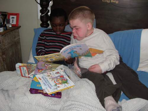 Courtesy | Julie Reneer  Brothers Yaw and Brigham Reneer, during the two-and-a-half months they spent between Yaw's arrival from Ghana and Brigham's death due to disability in 2009. Yaw was immediately drawn to Brigham, said their mother, Julie.