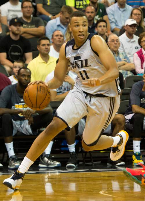 Rick Egan  |  The Salt Lake Tribune  Utah Jazz guard Dante Exum (11) brings the ball down court, in Utah Jazz Summer League action, Utah Jazz vs. The Boston Celtics, at EnergySolutions Arena, Monday, July 6, 2015.