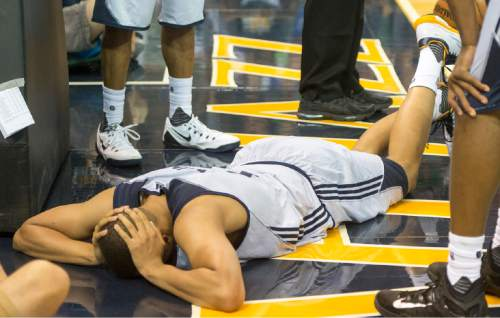 Rick Egan  |  The Salt Lake Tribune  Utah Jazz guard Dante Exum (11) lays on the floor after injuring his ankle, late in the game, in Utah Jazz Summer League action, Utah Jazz vs. The Boston Celtics, at EnergySolutions Arena, Monday, July 6, 2015.
