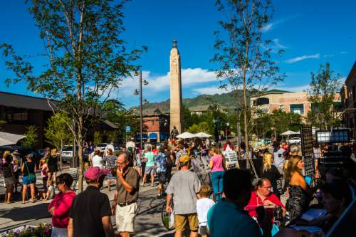 Chris Detrick  |  The Salt Lake Tribune The grand opening of the Sugar House Plaza Friday June 12, 2015. Sugar House Plaza has been reconfigured to be much larger than the old plaza surrounding the Sugar House Monument.