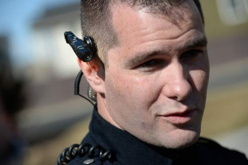 Francisco Kjolseth  |  Tribune file photo West Valley City patrol officer Wade Wright, discusses the workings of the department's body cameras.
