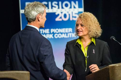Chris Detrick  |  Tribune file photo Salt Lake City Mayor Ralph Becker shakes the hand of former state legislator Jackie Biskupski after a debate earlier this month. A new Tribune poll shows Biskupski leading the two-term mayor.