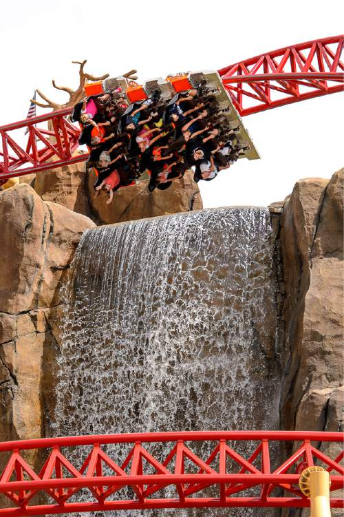 Trent Nelson     The Salt Lake Tribune Riders on Lagoon's new thrill ride Cannibal, Wednesday July 8, 2015. The roller coaster plunges riders into a 116 degree free-fall and up to 70 mph.