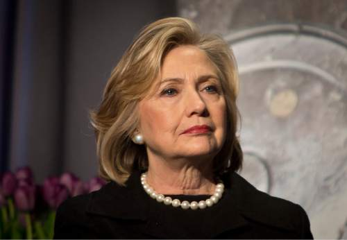 FILE - In this Friday, Nov. 21, 2014, file photo, Hillary Rodham Clinton listens before delivering remarks at an event in New York. Clinton has offered praise for President Barack Obama's executive actions to stave off deportation for millions of immigrants living in the U.S. illegally. But the Democrats' favored presidential hopeful has been less forthcoming on other issues in these early days of the 2016 contest. Clinton is not, so far, a candidate, and she's limiting her commentary about the daily news cycle confronting Obama. (AP Photo/Bebeto Matthews, File)