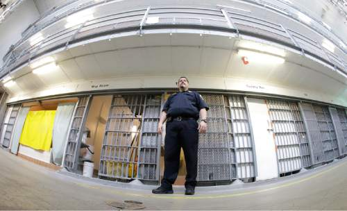 Warden Scott Crowther stands in front of cells in Wasatch A-East block during a media tour Thursday, Feb. 26, 2015, at the Utah State Correctional Facility in Draper. (AP Photo/Rick Bowmer, Pool)