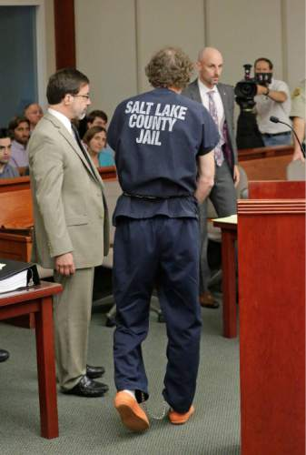 John Brickman Wall, a Salt Lake City pediatrician, walks off after speaking during a hearing Wednesday, July 8, 2015, in Salt Lake City. Wall was convicted of killing his cancer researcher ex-wife amid a bitter custody dispute and sentenced Wednesday, July 8, 2015 to 15 years to life in prison. (AP Photo/Rick Bowmer, Pool)