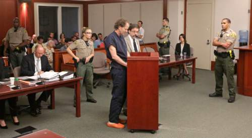 John Brickman Wall, a Salt Lake City pediatrician, speaks during a hearing Wednesday, July 8, 2015, in Salt Lake City. Wall was convicted of killing his cancer researcher ex-wife amid a bitter custody dispute and sentenced Wednesday, July 8, 2015 to 15 years to life in prison. (AP Photo/Rick Bowmer, Pool)