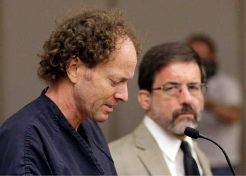 Rick Bowmer  |  Pool John Brickman Wall, left, a Salt Lake City pediatrician, speaks at a hearing while his attorney G. Fred Metos looks on Wednesday in Salt Lake City. Wall was convicted of killing his cancer researcher ex-wife amid a bitter custody dispute and sentenced Wednesday to 15 years to life in prison.