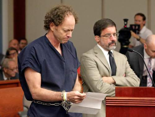 Rick Bowmer  |  Pool   John Brickman Wall, left, a Salt Lake City pediatrician, speaks at a hearing while his attorney G. Fred Metos looks on  Wednesday, July 8, 2015, in Salt Lake City. Wall was convicted of killing his cancer researcher ex-wife amid a bitter custody dispute and sentenced Wednesday, July 8, 2015 to 15 years to life in prison.