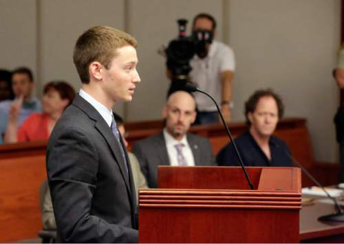 Rick Bowmer  |  Pool   Pelle Wall, left, speaks during a hearing while his father John Brickman Wall, right, looks on Wednesday, July 8, 2015, in Salt Lake City. Wall was convicted of killing his cancer researcher ex-wife amid a bitter custody dispute and sentenced Wednesday, July 8, 2015 to 15 years to life in prison.