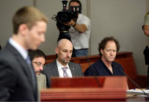 Rick Bowmer  |  Pool   John Brickman Wall, right, a Salt Lake City pediatrician, looks on while his son Pelle Wall speaking during a hearing Wednesday, July 8, 2015, in Salt Lake City. Wall was convicted of killing his cancer researcher ex-wife amid a bitter custody dispute and sentenced Wednesday, July 8, 2015 to 15 years to life in prison.