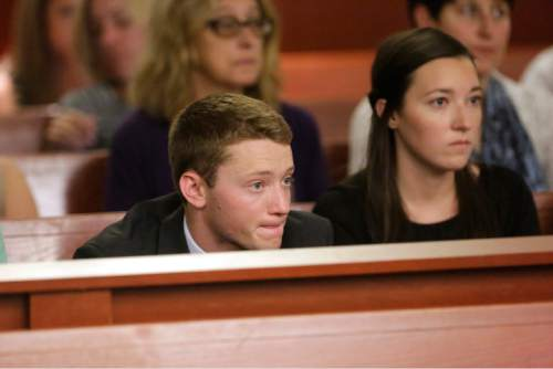 Rick Bowmer  |  Pool   Pelle Wall, left, looks on during his fathers sentencing Wednesday, July 8, 2015, in Salt Lake City. John Brickman Wall was convicted of killing his cancer researcher ex-wife amid a bitter custody dispute and given a sentence of 15 years to life by state Judge James Blanch.