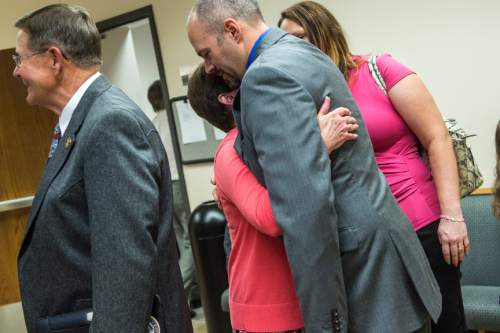 Chris Detrick  |  The Salt Lake Tribune Kathy Wride hugs Deputy Greg Sherwood after the sentencing of Meagan Grunwald at 4th District Court in Provo Wednesday July 8, 2015.  Eighteen-year-old Meagan Grunwald was sentenced Wednesday to 25 years to life in prison for being an accomplice to the murder last year of Utah County Sheriff's Sgt. Cory Wride and the attempted murder of Deputy Greg Sherwood.