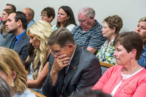 Chris Detrick  |  The Salt Lake Tribune Nathan Moeller, Nannette Wride, Blake Wride and Kathy Wride listen during the sentencing of Meagan Grunwald at 4th District Court in Provo Wednesday July 8, 2015.  Eighteen-year-old Meagan Grunwald was sentenced Wednesday to 25 years to life in prison for being an accomplice to the murder last year of Utah County Sheriff's Sgt. Cory Wride and the attempted murder of Deputy Greg Sherwood.