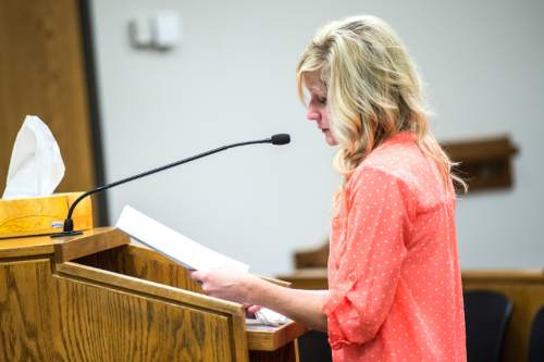 Chris Detrick  |  The Salt Lake Tribune  Ann Curtis speaks during the sentencing of Meagan Grunwald at 4th District Court in Provo Wednesday July 8, 2015.  Eighteen-year-old Meagan Grunwald was sentenced Wednesday to 25 years to life in prison for being an accomplice to the murder last year of Utah County Sheriff's Sgt. Cory Wride and the attempted murder of Deputy Greg Sherwood.
