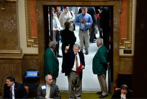 Scott Sommerdorf   |  Tribune file photo Rep. R. Curt Webb, R-Logan, votes as he steps onto the floor in the Utah House of Representatives during the 2015 session. Behind him in the hallway are the usual crowd of lobbyists.