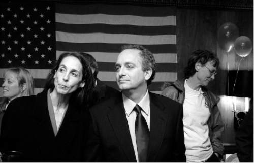 Salt Lake City mayoral candidate Frank Pignanelli, with his wife Darcy looks at results as 90% of precints had reported with Rocky Anderson receiving 55% of the vote, at his election night party Tuesday night in Salt Lake City. Photo by Trent Nelson; 11/04/2003