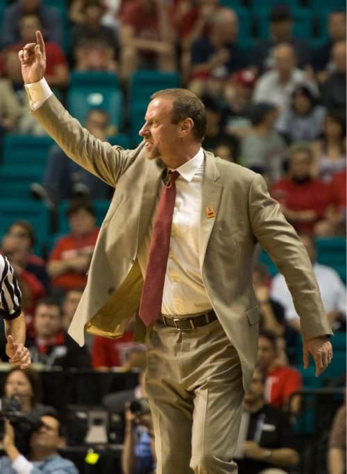 Rick Egan  |  The Salt Lake Tribune  Utah Utes head coach larry Krystkowiak shouts instructions to his team, in Pac-12 Basketball Championship action Utah vs. Oregon, at the MGM Arena, in Las Vegas, Friday, March 13, 2015.